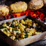 Rôtis et légumes au feu de bois